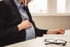 Pregnant business woman royalty free stock image