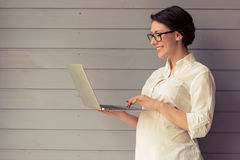 Pregnant business woman with gadget Stock Images