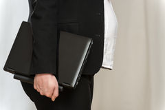 Pregnant business woman with laptop royalty free stock photos
