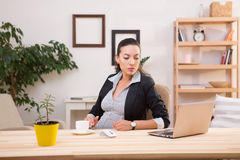 Pregnant business woman working Royalty Free Stock Photo