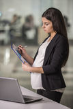 Pregnant businesswoman Stock Photography