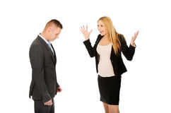 Pregnant businesswoman arguing with her partner Stock Photo