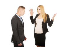 Pregnant businesswoman arguing with her partner Royalty Free Stock Images