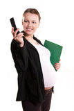 Pregnant businesswoman with a cell-phone. Pregnant smiling businesswoman with a cell-phone against white background Stock Image