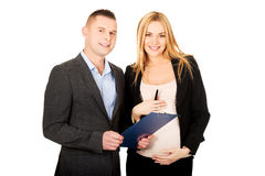Pregnant businesswoman with her partner Royalty Free Stock Images