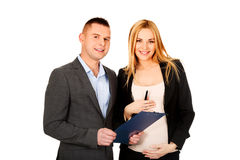 Pregnant businesswoman with her partner Royalty Free Stock Image