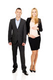 Pregnant businesswoman with her partner Royalty Free Stock Photo