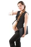 Pregnant businesswoman with laptop with finger shows positive Stock Photo