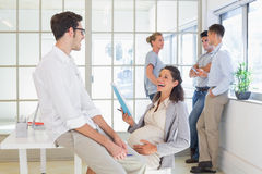 Pregnant businesswoman laughing with colleague Royalty Free Stock Photos