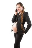Pregnant businesswoman with mobile phone Stock Photos
