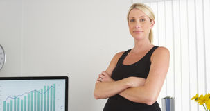 Pregnant businesswoman smiling in the office Royalty Free Stock Photo