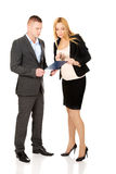 Pregnant businesswoman talking with her partner Stock Image