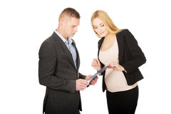Pregnant businesswoman talking with her partner Royalty Free Stock Photography