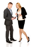 Pregnant businesswoman talking with her partner Stock Photo