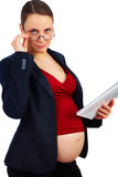Pregnant businesswoman at work Stock Photo