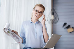 Pregnant businesswoman working at home Stock Images