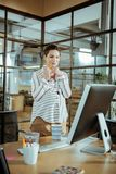 Young pregnant businesswoman working in modern office royalty free stock photography