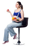 Pregnant caucasian woman holds vegetables and fruits Royalty Free Stock Photo