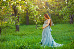 Pregnant caucasian woman takes rest outdoor Stock Images