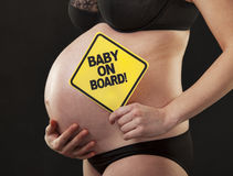 Pregnant close abdomen sign Royalty Free Stock Images