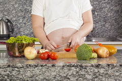 Pregnant cook Royalty Free Stock Image