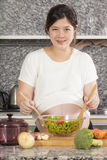 Pregnant cook Stock Image