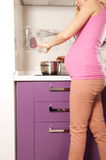 Pregnant cooking Royalty Free Stock Photo