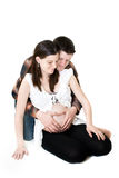 Pregnant Couple. Young Pregnant couple on white background (not isolated royalty free stock photo