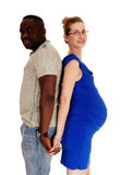 Pregnant couple back to back. Stock Photography