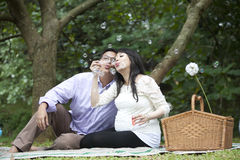 Pregnant couple blowing bubbles Stock Images