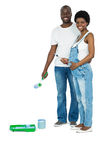 Pregnant couple with blue paint tin Stock Photo