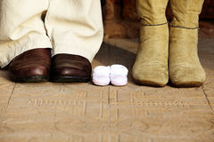 Pregnant couple boots Royalty Free Stock Photos