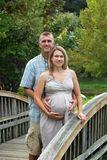 Pregnant Couple on a Bridge Royalty Free Stock Photography