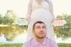 Pregnant couple choosing gender of the baby, the child's name. T Stock Images