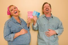 Pregnant Couple Deciding on Pink of Blue Paint Stock Photos
