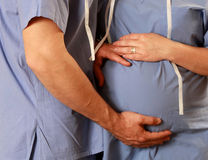 Pregnant couple doctors Stock Photography
