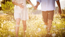 Pregnant couple. Happy and young pregnant couple hugging in nature royalty free stock images