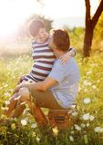 Pregnant couple. Happy and young pregnant couple hugging in nature stock photo
