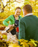 Pregnant couple having picnic in autumn park Royalty Free Stock Images