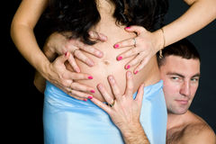 Pregnant couple holding belly by hands Royalty Free Stock Photos