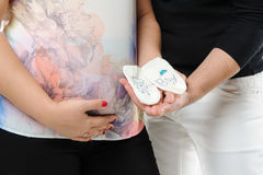 Pregnant couple holding socks Stock Photography
