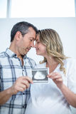 Pregnant couple at home Stock Image