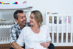 Pregnant couple at home Royalty Free Stock Images
