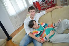 Pregnant couple at home using tablet computer Stock Photography