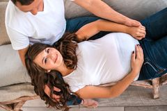 Pregnant couple hug and hold pregnant belly. royalty free stock images