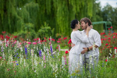 Pregnant couple hugging in nature Stock Photo