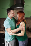 Pregnant couple at the kitchen Stock Images
