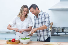 Pregnant couple in kitchen Royalty Free Stock Image