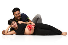 Pregnant couple laying Royalty Free Stock Photography