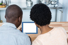 Pregnant couple looking at digital tablet Stock Images